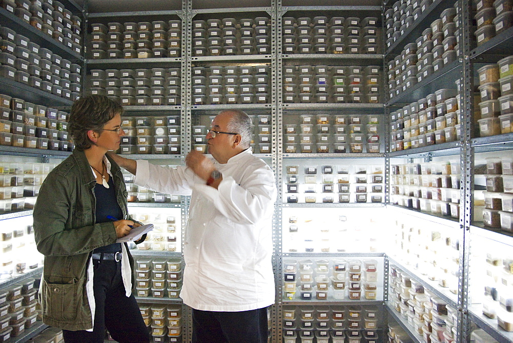 3 star chef Juan Mari Arzak in his chamber with spices, banco de sabores, with more than 3000 herbs from all over the world, here with the author Cordula Rabe, Donostia, San Sebastian, Basque Country, Spain