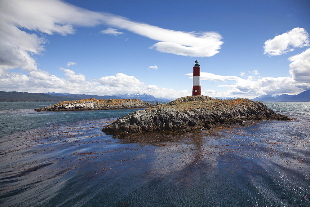 Lighthouse and sea lions on island in Beagle Channel, near Ushuaia, Tierra del Fuego, Patagonia, Argentina, South America