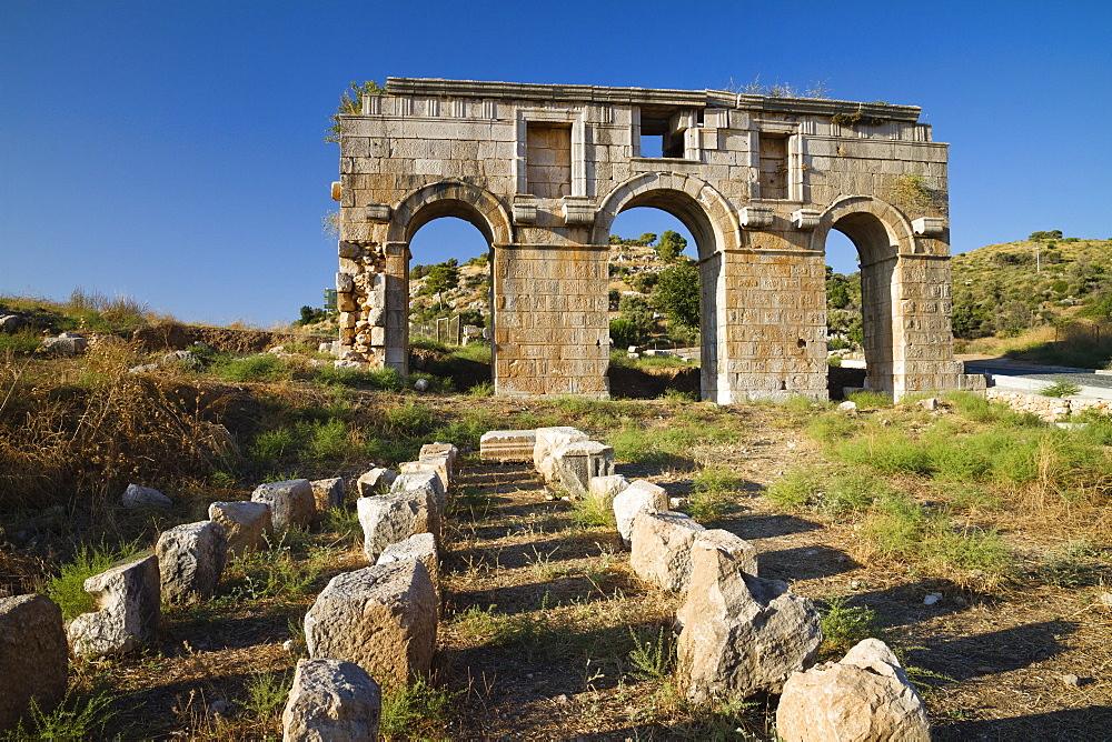 Triple arched gateway of ancient Patara, Triumphal arch of Metius Modestus, lycian coast, Mediterranean Sea, Turkey