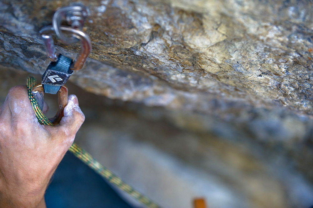 Rock climbing, hand with carabiner next to a rock face, Oetztal, Tyrol, Austria
