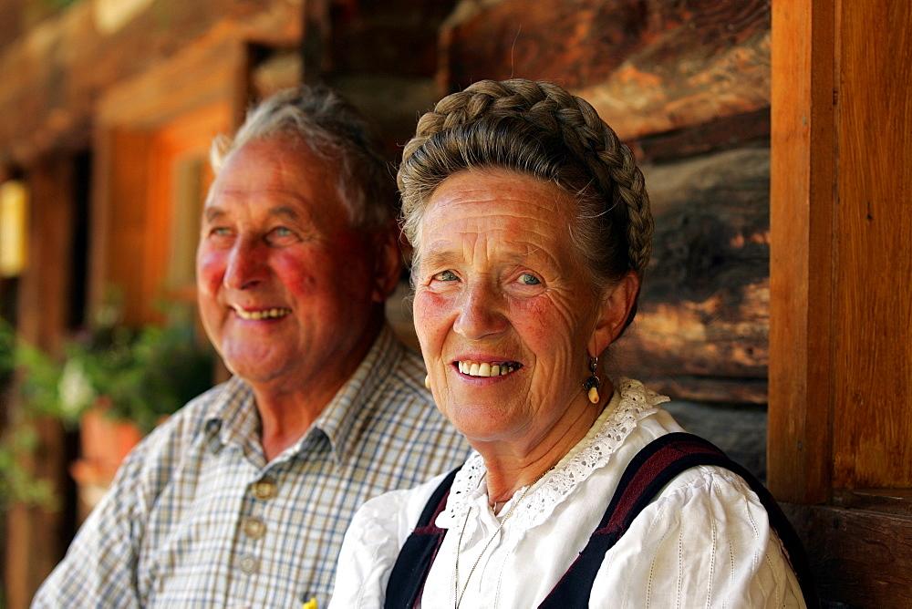 Senior couple in front of the Maurachalm, National Park Hohe Tauern, Salzburg State, Austria