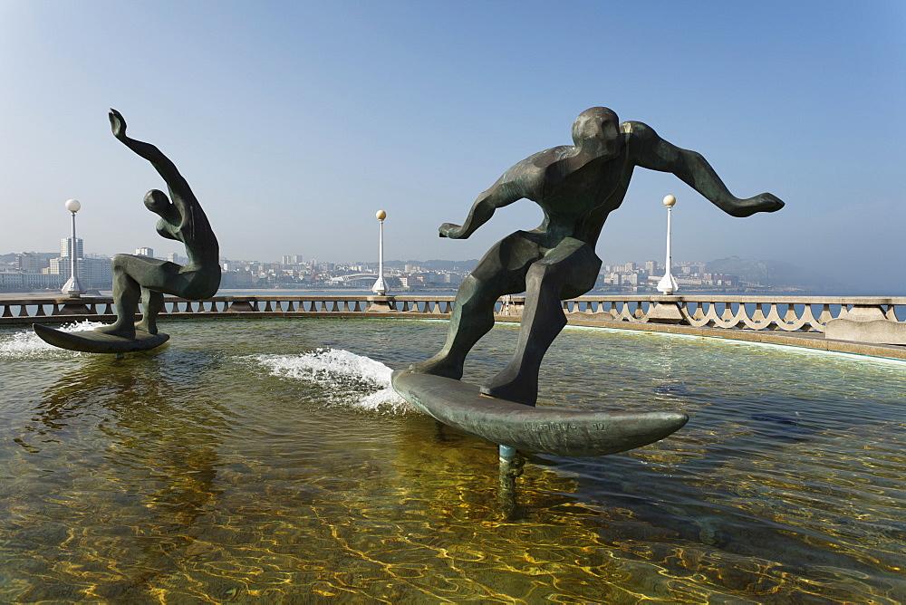 Fountain with sculpture, surfer, seaside promenade, La Coruna, A Coruna, Camino Ingles, Camino de Santiago, Way of Saint James, pilgrims way, province of La Coruna, Galicia, Northern Spain, Spain, Europe