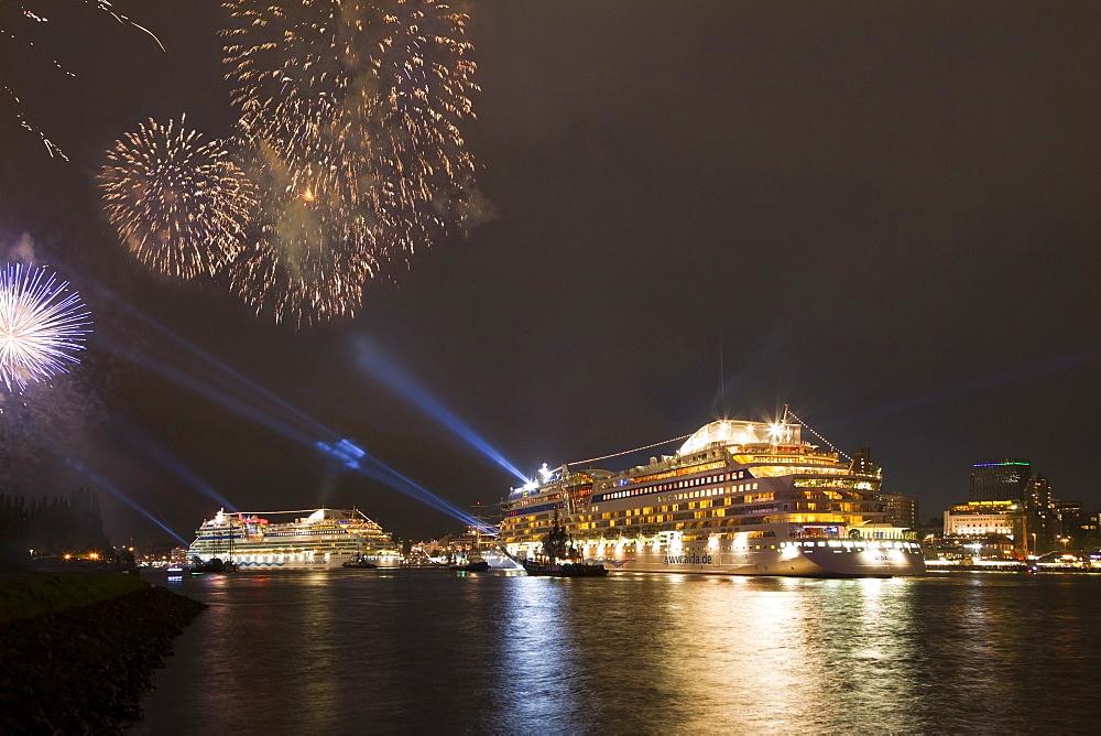 Fireworks above cruise ships AIDAblu and AIDAluna clearing port, Hamburg, Germany, Europe