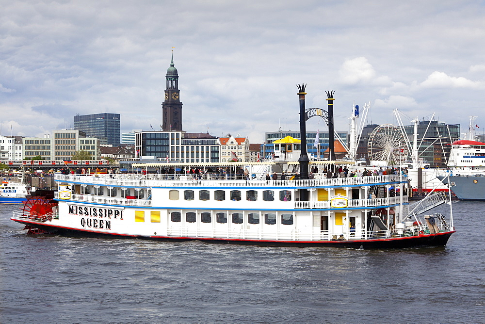 Paddle wheel steamer Mississippi Queen at the harbour in front of St Michaelis church, Hamburg, Germany, Europe