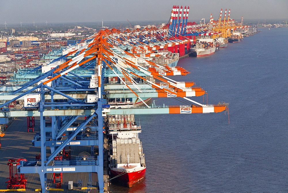 Aerial view of container port Bremerhaven, freighters being loaded by cranes, Weser Rivermouth, Bremerhaven, Bremen, Northern Germany