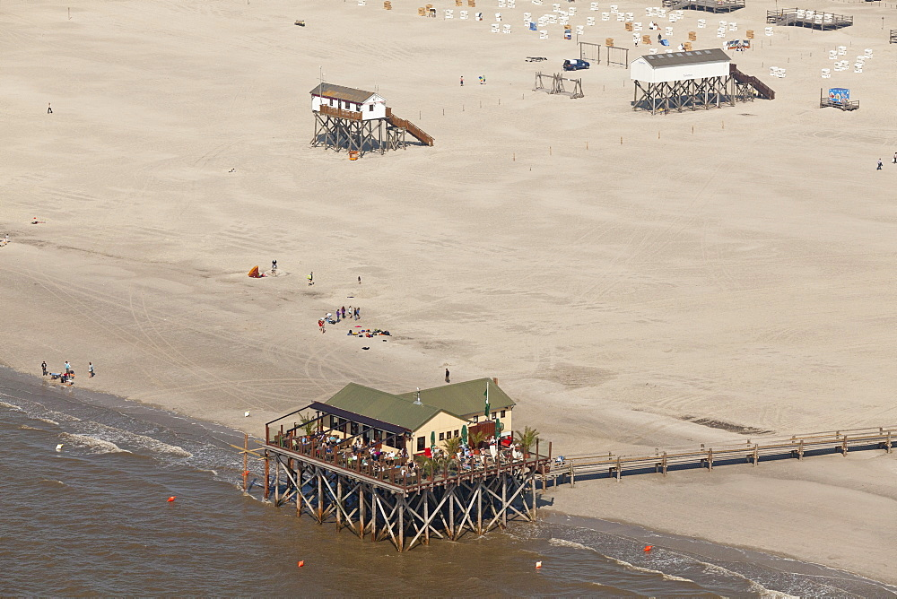 Aerial view of stilted buildings on the beach, North Sea coast, St Peter-Ording, North Friesland, Schleswig-Holstein, Germany