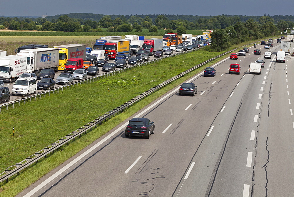 Traffic at a standstill on a German Autobahn, traffic jam, oncoming traffic is flowing, Bavaria, Germany