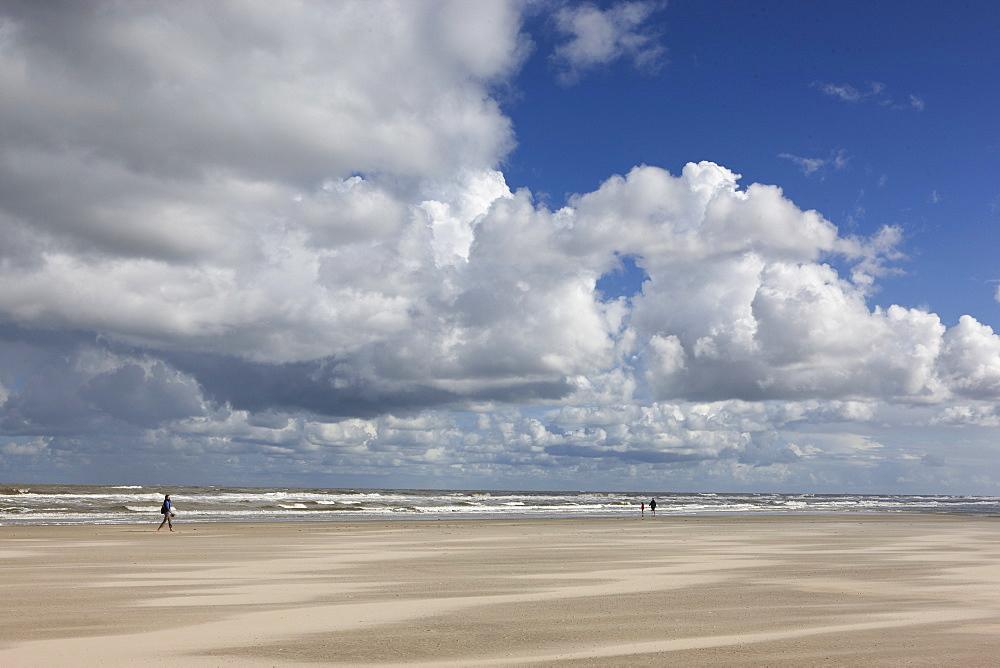 Sweeping North Beach under clouded sky, Island of Spiekeroog, East Frisian Islands, Lower Saxony, Germany, Europe