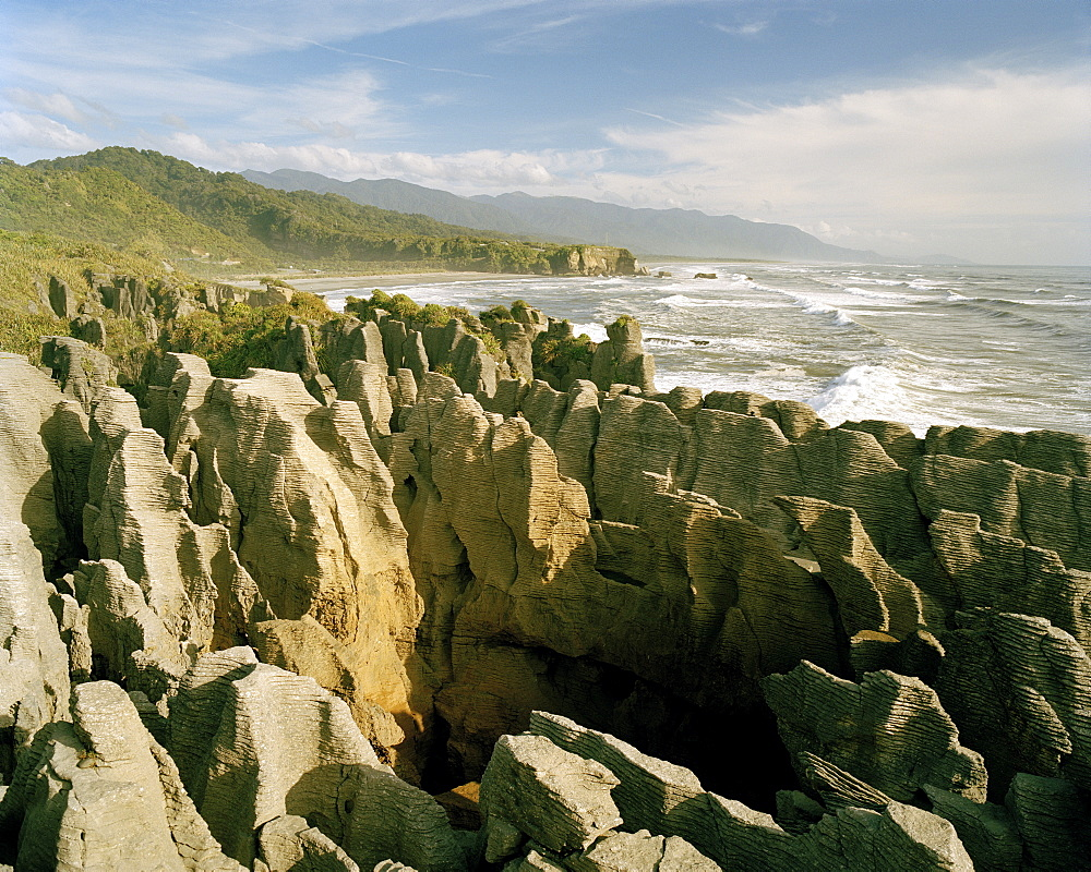 Pancake Rocks, rock formation on the waterfront in the sunlight, Punakaiki, West coast, South Island, New Zealand