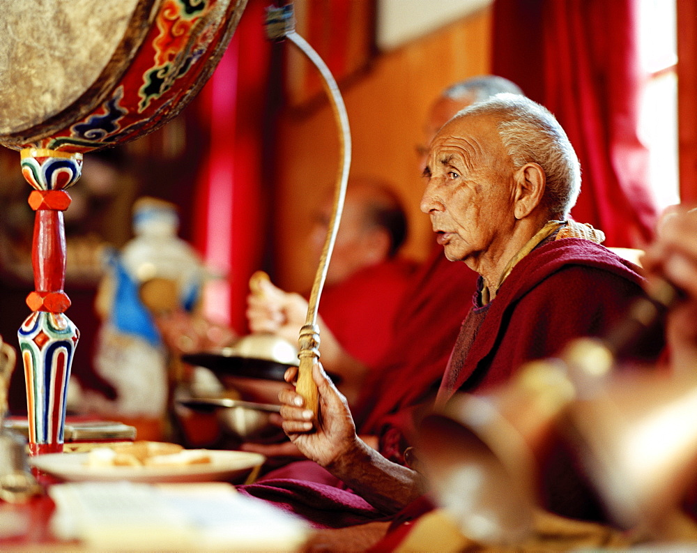 Monks celebrating, praying and playing music at the convent Thagchokling, village Ney, Ladakh, Jammu and Kashmir, India