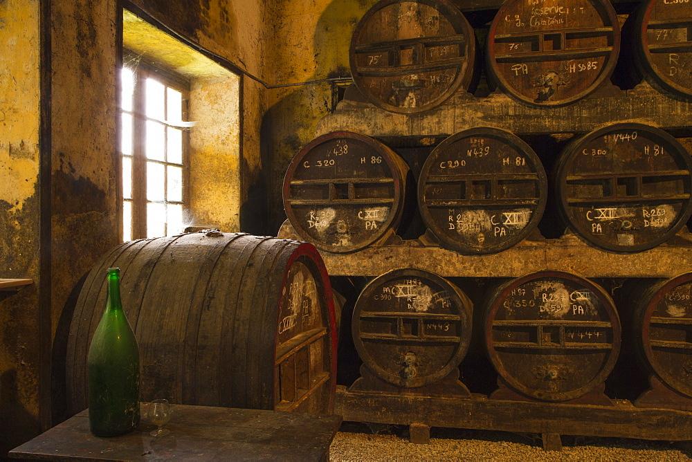 Ageing barrels at Chateau du Breuil Calvados distillery, Le Breuil en Auge, Calvados, Basse-Normandy, France