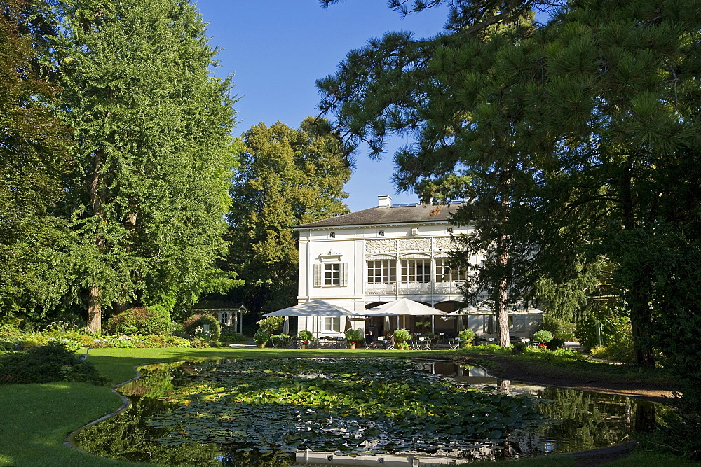 Pond and house at Merian Park, Brueglingen, Basel, Switzerland, Europe
