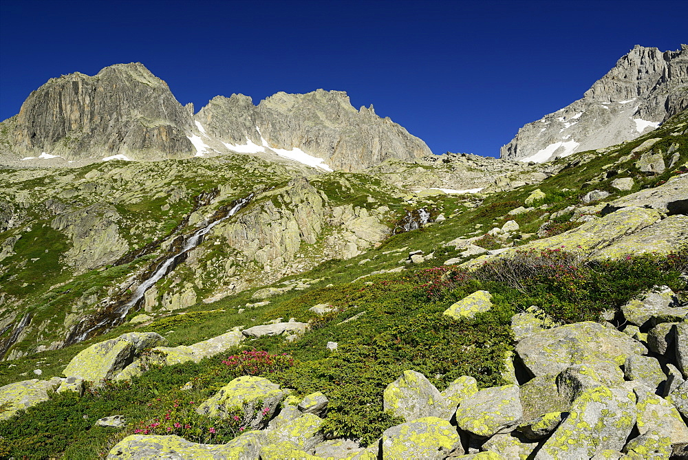High mountain landscape with boulders and stream, Alpe di Rotondo, Gotthard range, Ticino, Switzerland