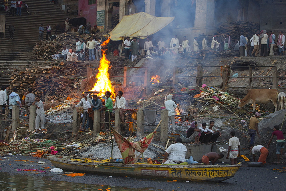 Cremation fire at Manikarnika Ghat alongside Ganges river, Varanasi, Uttar Pradesh, India