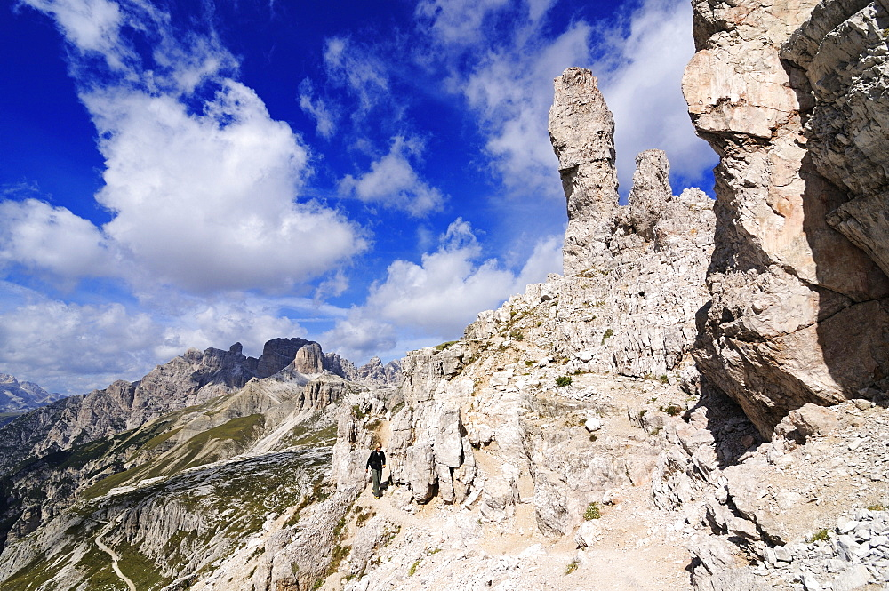 Teenager climbing on the Paternkofel fixed rope route past the Frankfurter Wuerstel rock, via ferrata, Boedenseen, Hochpustertal, Dolomites, South Tyrol, Italy