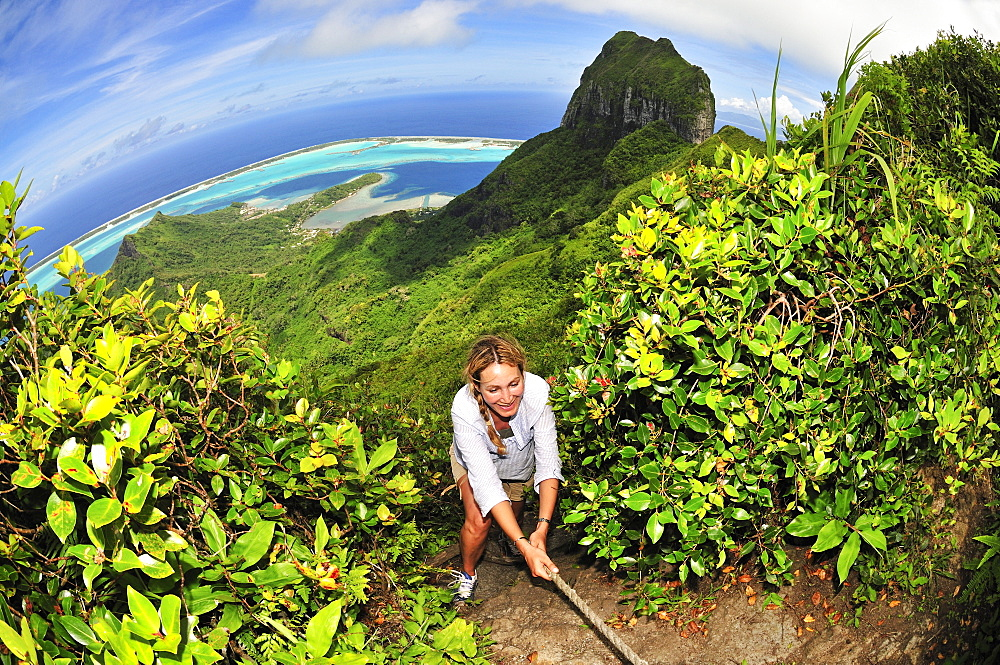 Woman trekking up Mount Pahia, Bora Bora, Society Islands, French Polynesia, Windward Islands, South Pacific