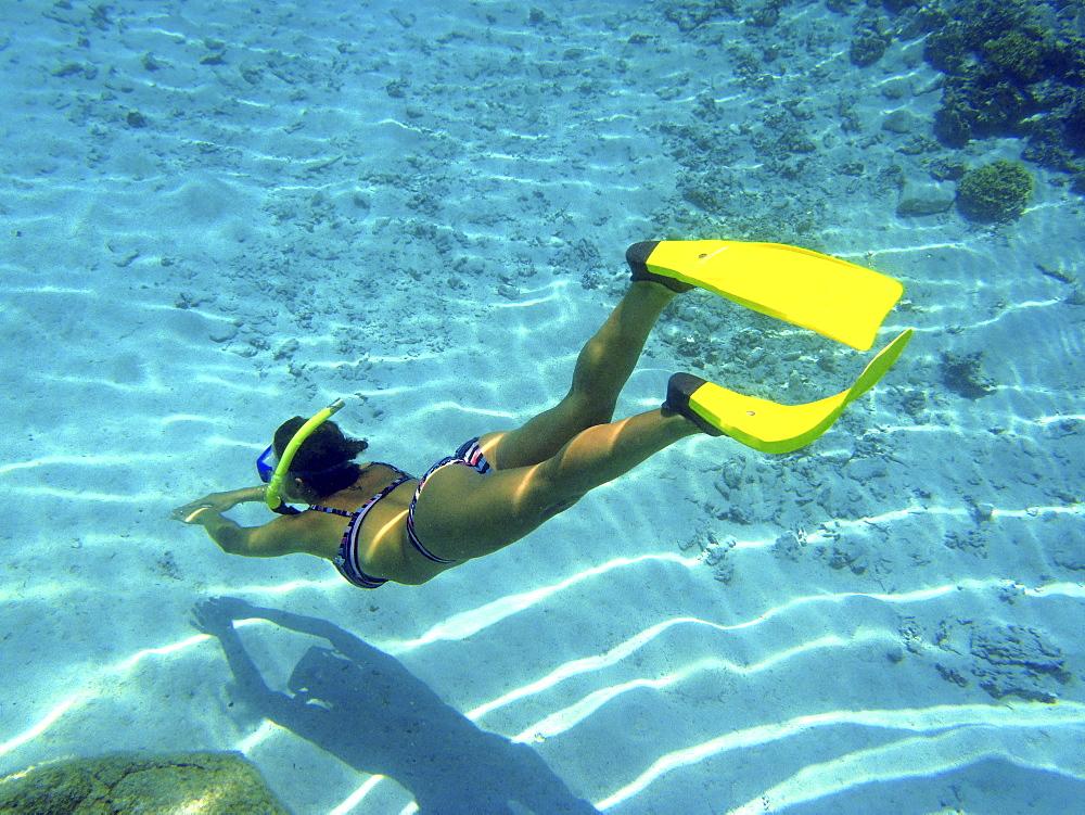 Woman snorkelling, Bora Bora, Society Islands, French Polynesia, Windward Islands, South Pacific
