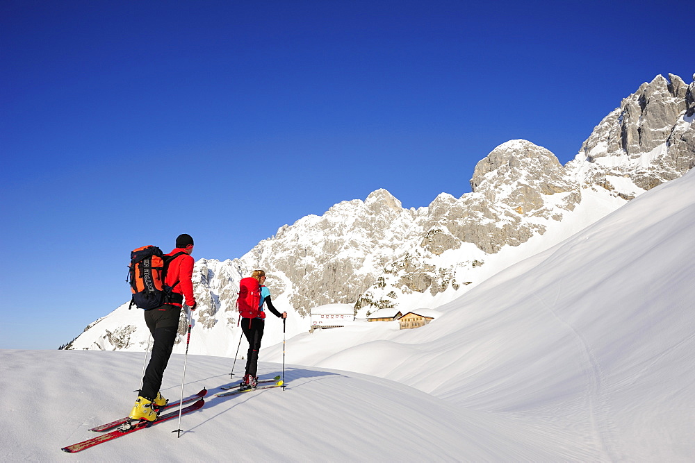 Two backcountry skiers ascending to hut Gruttenhuette, Kaiser-Express, Rote-Rinn-Scharte, Wilder Kaiser, Kaiser mountain range, Tyrol, Austria