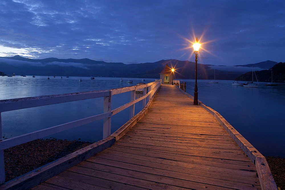 Sunset at the pavilion on Daly's Wharf, Akaroa jetty Banks Peninsula, Canterbury, South Island, New Zealand