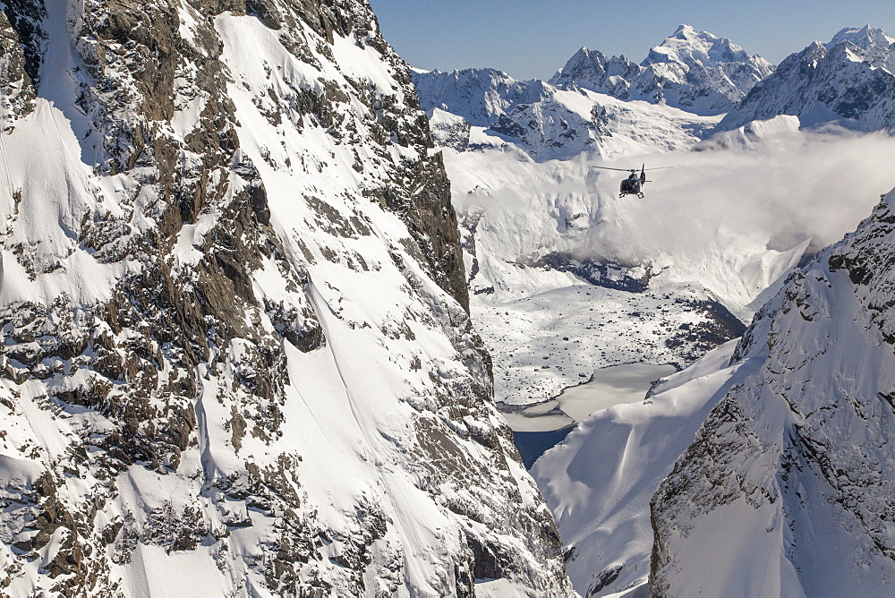 Helicopter flight through a ravine in snowy mountains, Southern Alps, South Island, New Zealand