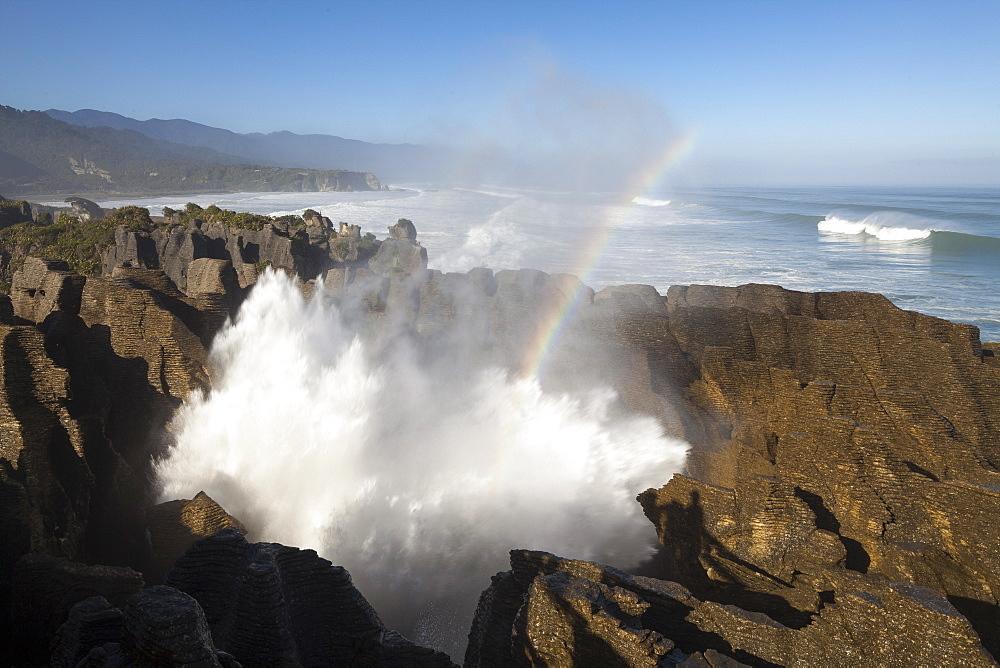 Rainbow over Pancake rocks at Punakaiki, Dolomite Point, Tasman Sea, South Island, New Zealand