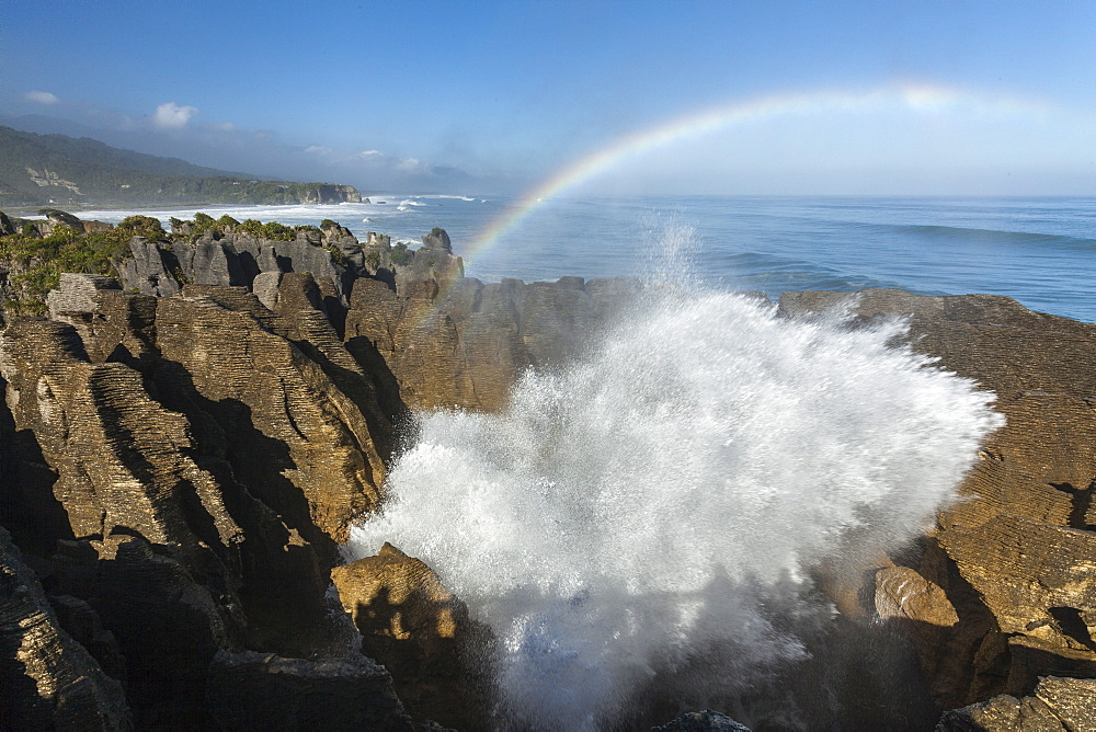 Rainbow over Pancake rocks at Punakaiki, Dolomite Point, Tasman Sea, South Island, New Zealand