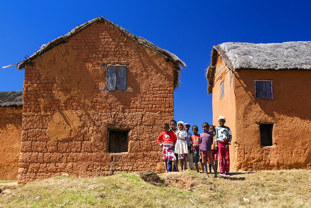 Children and houses west of Antananarivo, Merina people, Madagascar, Africa