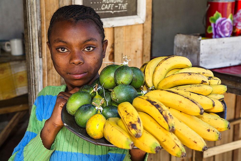 Magdagascan girl selling fruits, Merina People, highlands, Madagascar, Africa