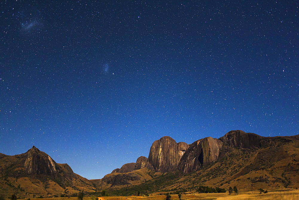 Southern starry Sky with the Magellanic Clouds over the Tsaranoro Mountain Range, South Madagascar, Africa