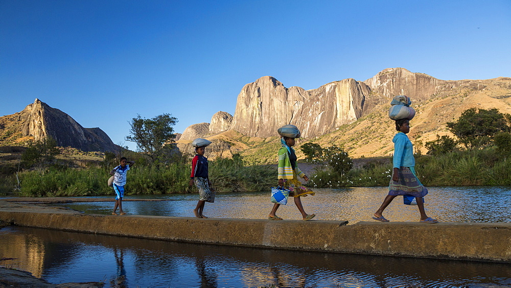 Madagascan girls in front of the Tsaranoro Massif, highlands, South Madagascar, Africa