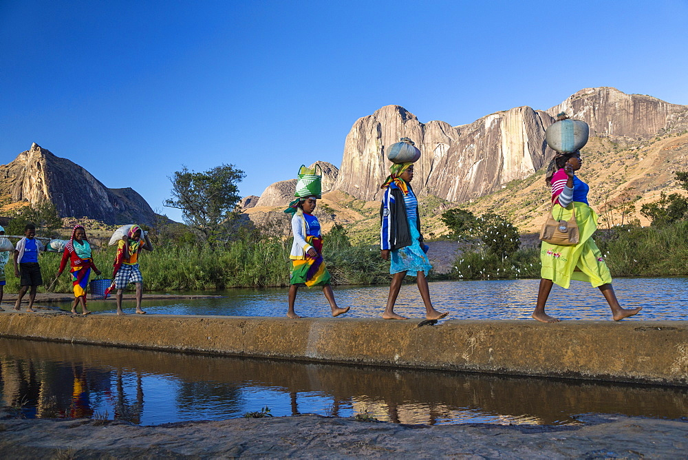 Madagascan women in front of the Tsaranoro Massif, highlands, South Madagascar, Africa