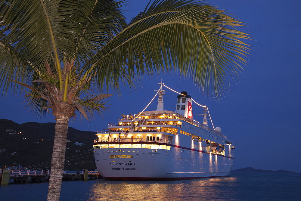 Cruise ship MS Deutschland (Reederei Peter Deilmann) at pier and palm tree at dusk, Tortola, Tortola, British Virgin Islands, Caribbean