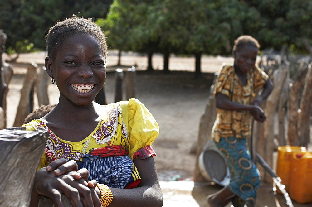 Two girls at a well, Magadala, Mali