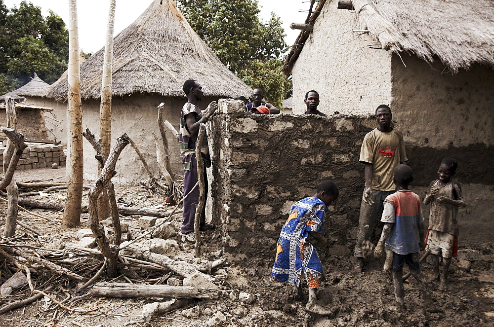 Villagers building an adobe hut, Magadala, Mali
