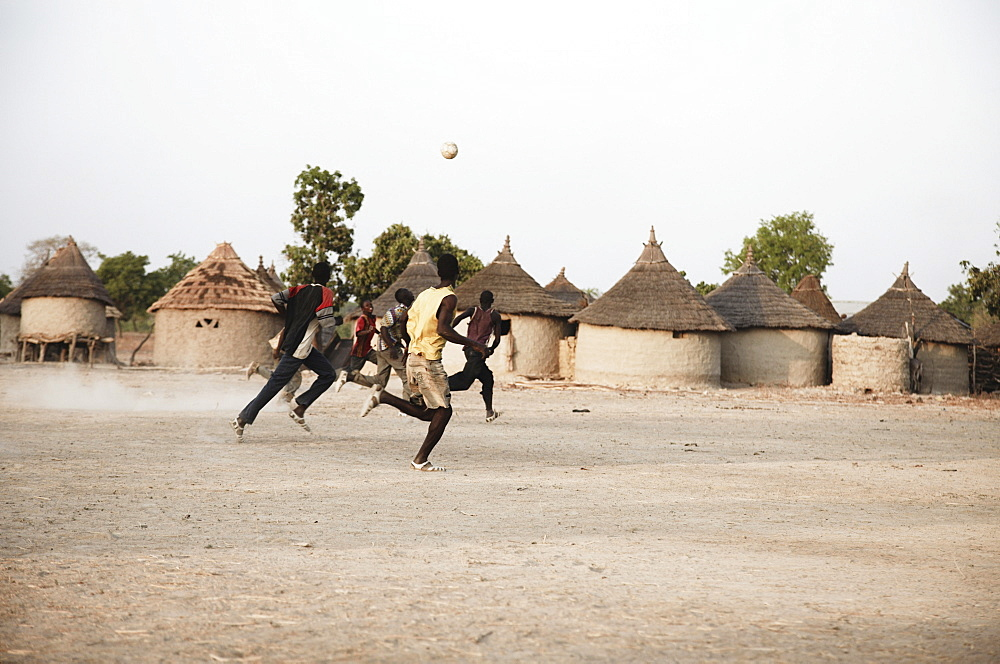Boys playing soccer, Magadala, Mali