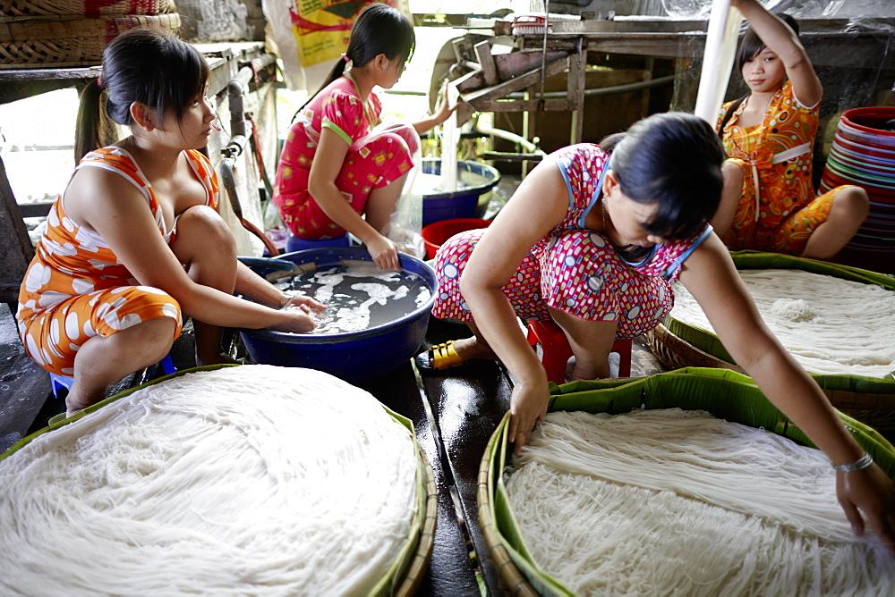 Women working in a rice noodles manufactory, Long Xuyen, An Giang Province, Vietnam