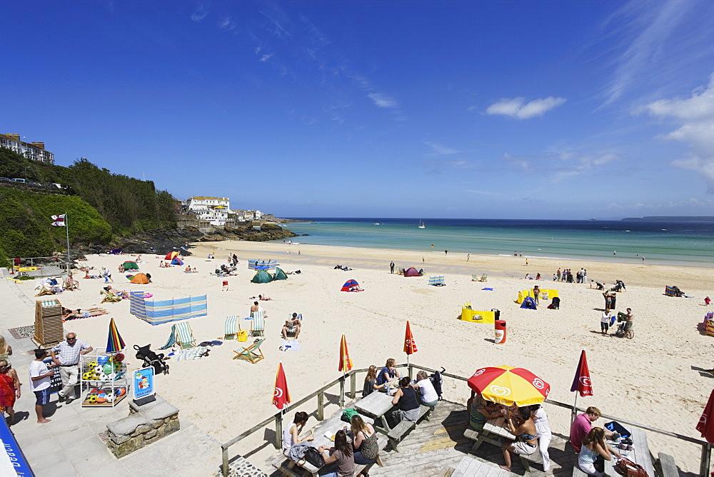 People sunbathing at Porthminster Beach, St. Ives, Cornwall, England, United Kingdom
