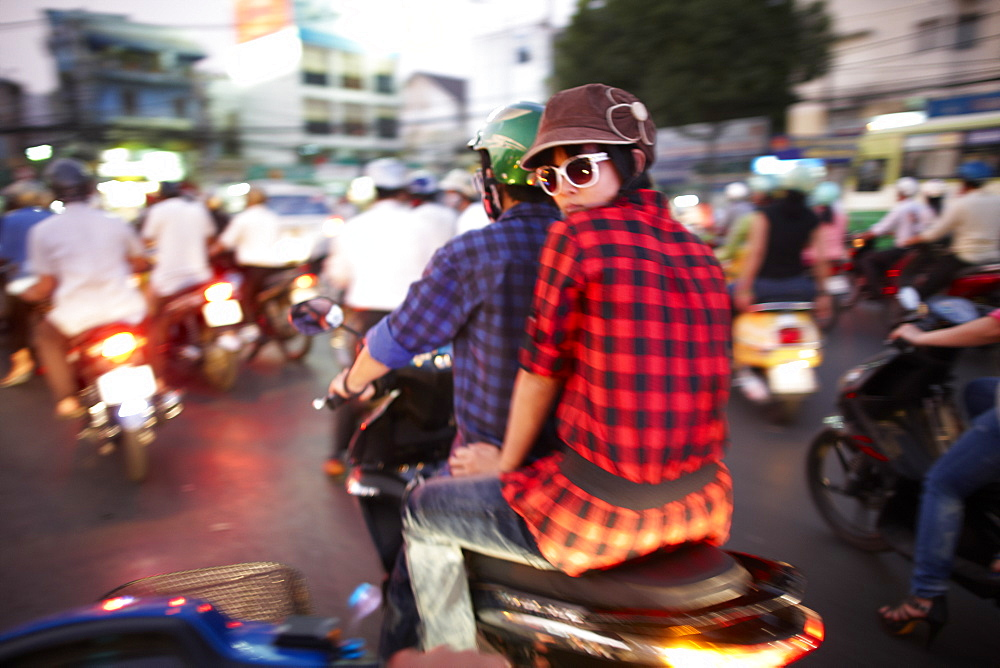Scooterists in the evening, Ho-Chi-Minh City, Vietnam