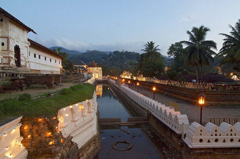 The Temple of the Tooth Sri Dalada Maligawa with fairy light garlands ready for the perahera festival, Kandy, Sri Lanka