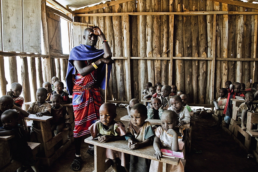 Children and teacher in a Massai village school, Kenya, Africa