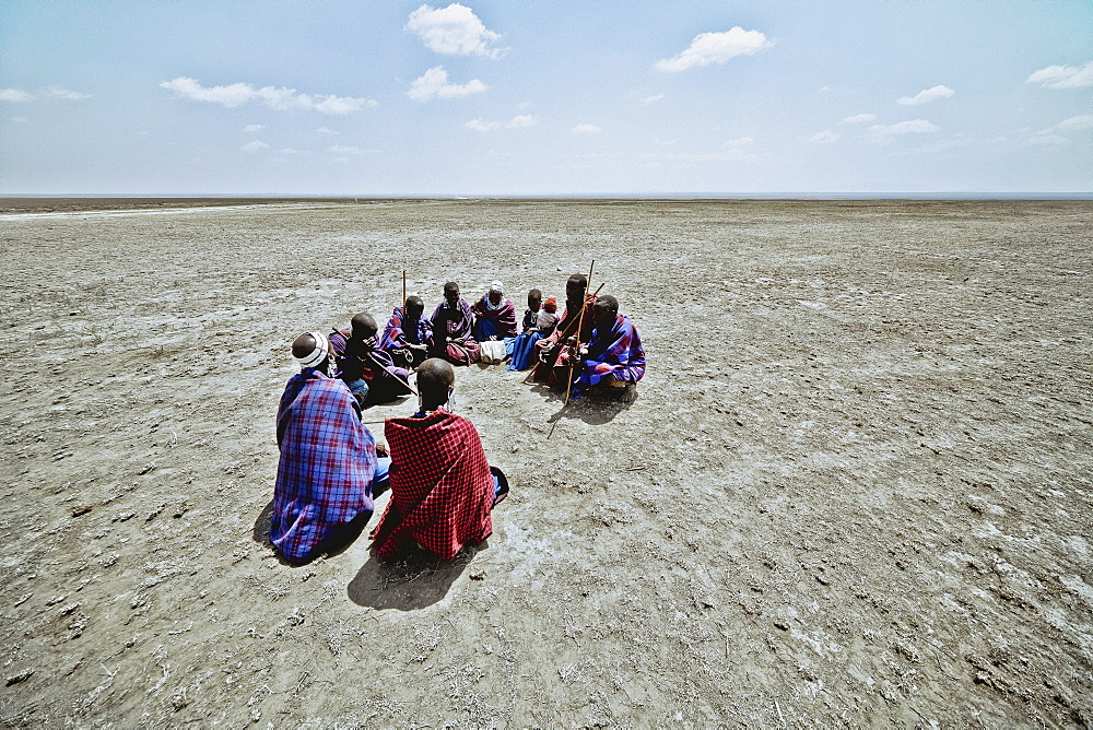 Massai's sitting in a circle in the plains, Ngorongoro, Tanzania, Africa