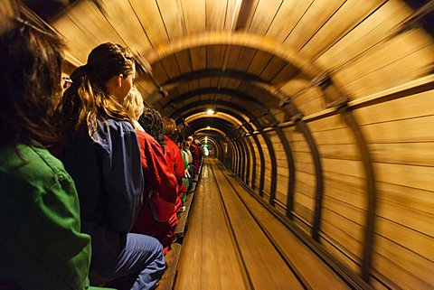 People on mine train in salt mine Grubenhund in the tunnel, Hallstatt, Salzkammergut, Upper Austria, Austria, Europe