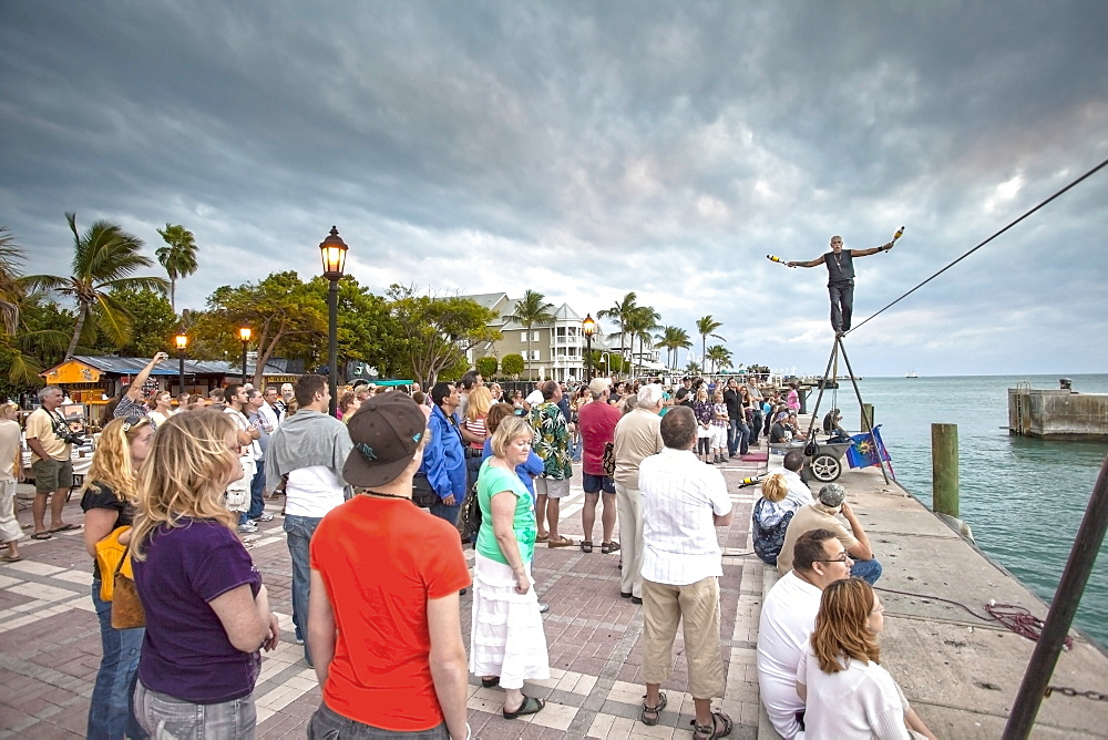 Tightrope walker at the Daily Sunset Celebrations, Mallory Square, Key West, Florida Keys, Florida, USA