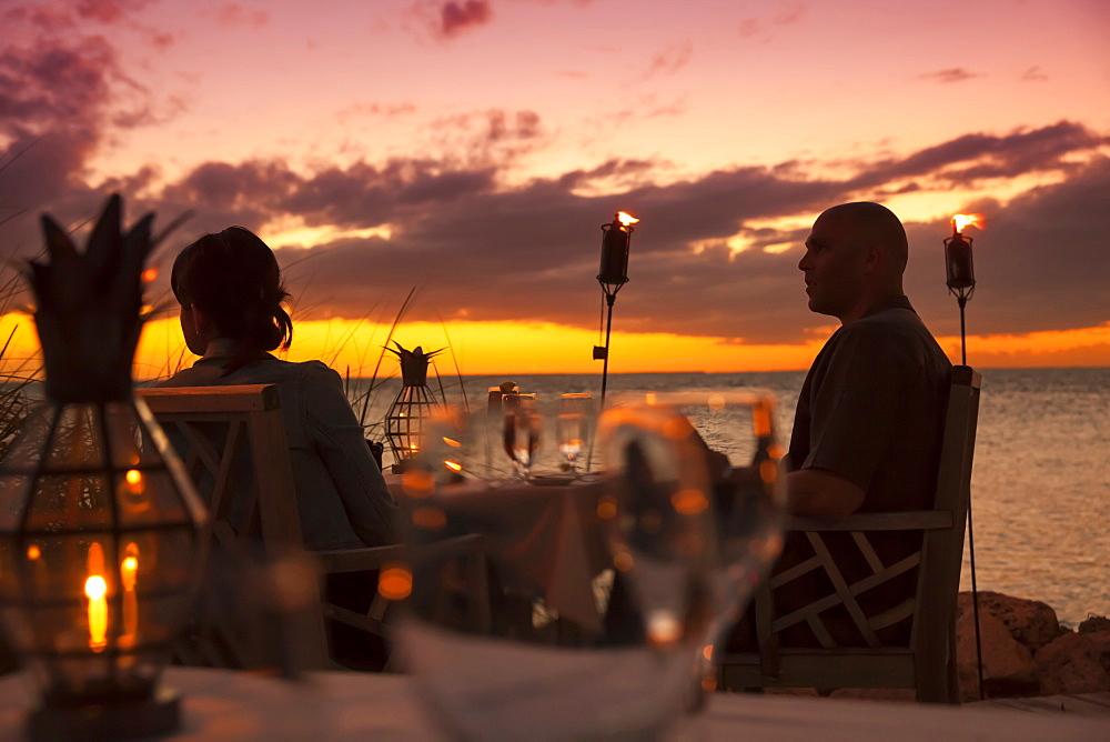 Dining couple at Restaurant DINING ROOM at sunset, Little Palm Island Resort, Florida Keys, USA
