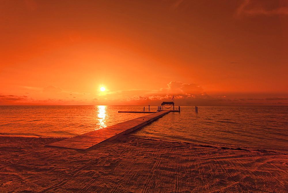 Beach with landing stage in the morning light at sunrise, Moorings Village Resort, Islamorada, Florida Keys, Florida, USA