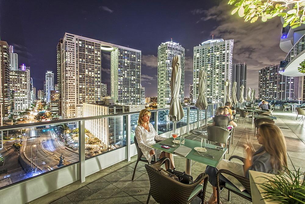 Terrace of gourmet restaurant Area 31 at hotel Epic, Downtown Miami, Miami, Florida, USA