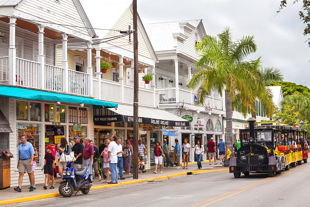 The Conch Tour Train on the main shopping street, Duval Street, Key West, Florida Keys, USA