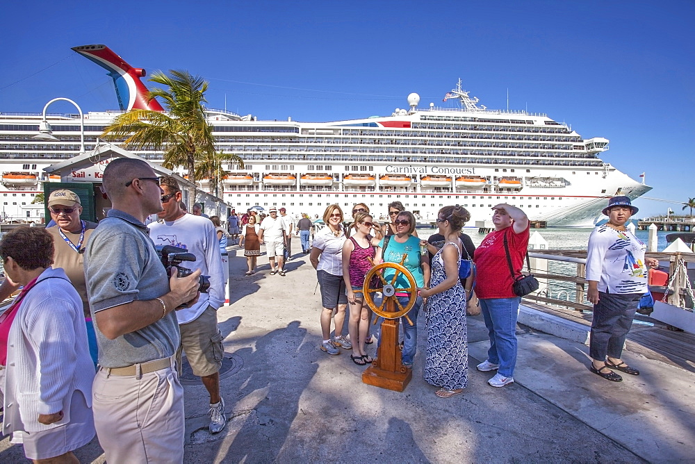 Tourists in front of luxury cruise ship docked at the port of Key West, Florida Keys, Florida, USA