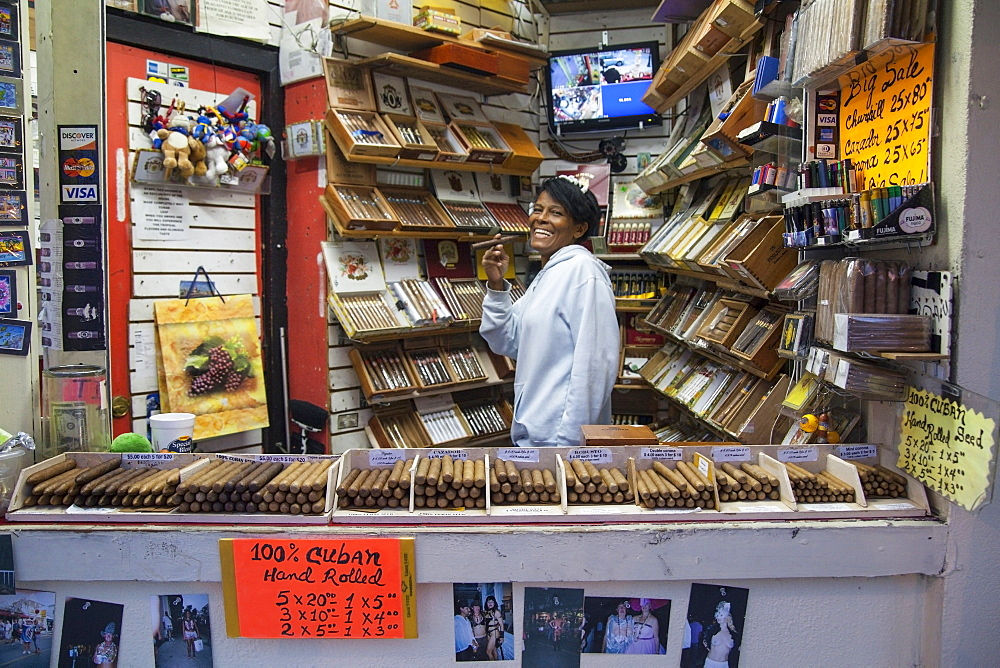 Woman selling cigars in a tobacco shop on Duval Street, Key West, Florida Keys, USA
