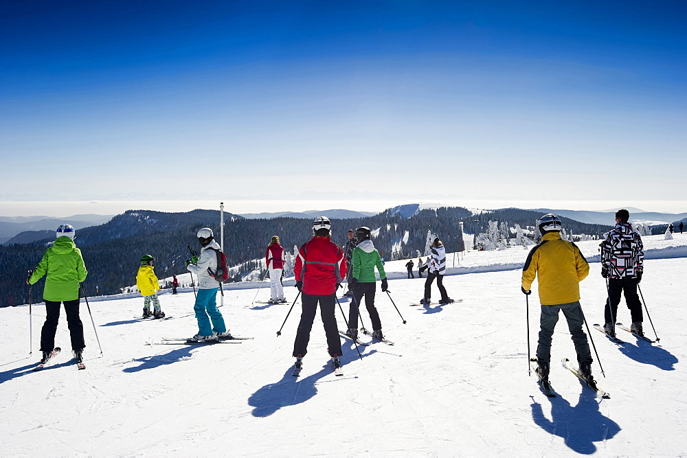 Skiers on the summit of Feldberg, Black Forest, Baden-Wuerttemberg, Germany